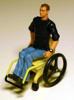 Actionfigur Jake Sully im Rollstuhl sitzend