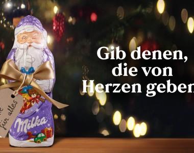 Milka Schoko-Weihnachtsmann mit Text: Gib denen, die von Herzen geben.