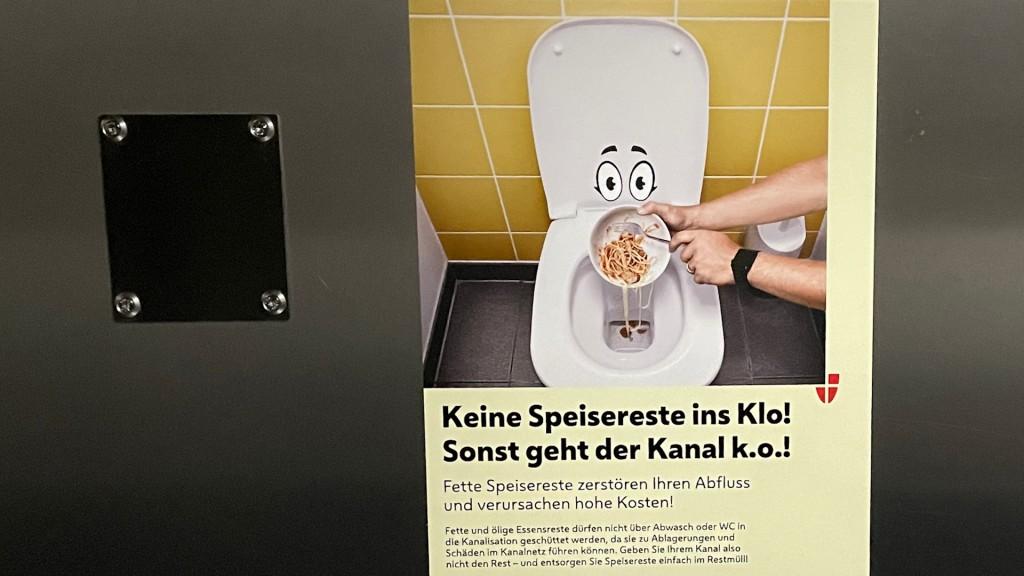 Plakat mit dem Text: Keine Speisereste ins Klo!